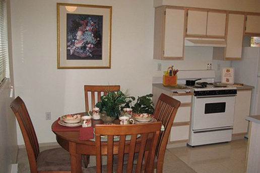 kitchen and dining area, white cabinets and white appliances