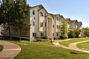 K building with sidewalk paths, handrails, grass