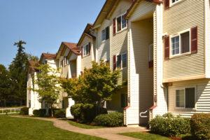 exterior building, sidewalk, grass, shrubs and trees
