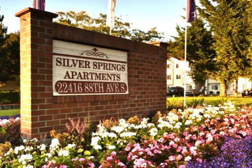 Silver Springs Apartments 22416 88th Ave S brick sign, flowers